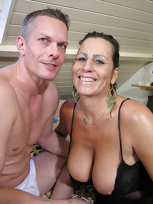 Hot and horny mature couple going at it