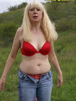 This mature slut loves to get fucked in an open field