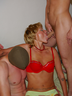 Horny mature sluts in gangbang action
