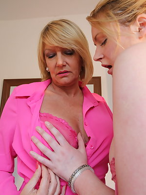 Naughty British housewife having fun with a young lesbian babe