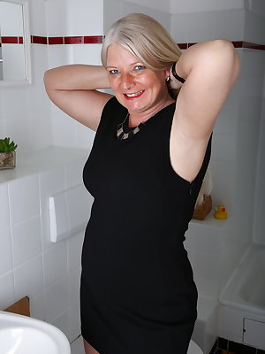 Naughty German housewife taking a shower