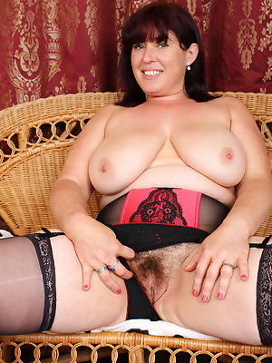 Hairy British housewife playing on her couch