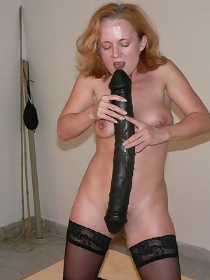 Kinky matue slut stuffing her cunt with a huge toy