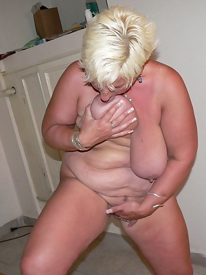 See this blonde mature get down on huge toys