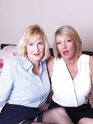 Two naughty mature British lesbians make out
