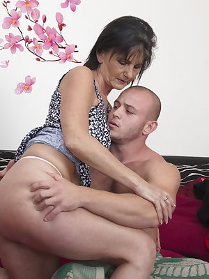 Horny mature slut doing her toy boy
