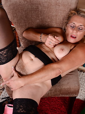 Hairy American mature lady playing alone