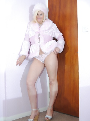Pictures of Platinum Blonde wearing her pink fur coat and hat plus sexy pink panties. Watch her flash her large E cup ma