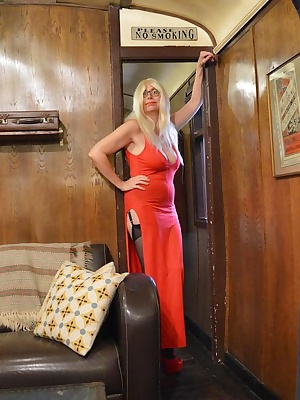 Barby shows off her new red dress and shoes at her secluded holiday home by the sea and strips off In full view of any p