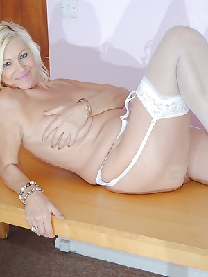 Platinum blond is just in stockings and suspenders some black and some white watch as she spreads her legs and opens her