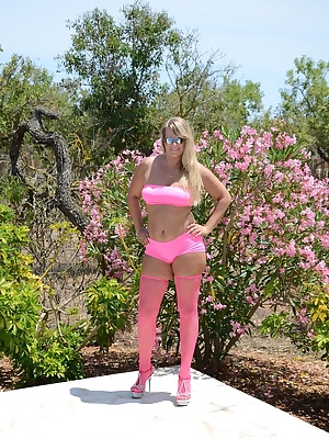 I have pink stockings and high-heels at poolside by the Sun it appears so bright. Is it me