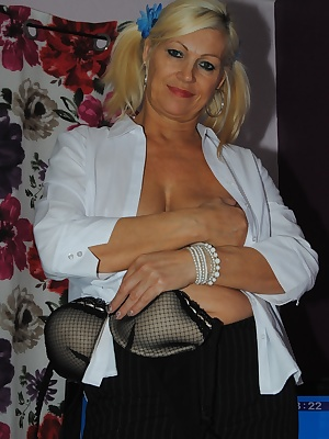 Pictures of me in a open shirt showing my lovely mature tits, stockings and suspender and short skirt which soon gets re