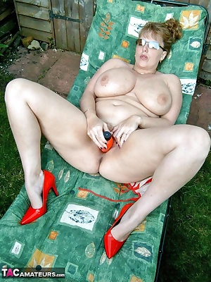Outside, in the evening sun, bikini coming off and a dildo at hand, what else is a girl supposed to do to keep herself a