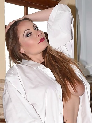 Pictures of Sophia in her Mans shirt and stockings flashing her E cup tits, bum and pussy