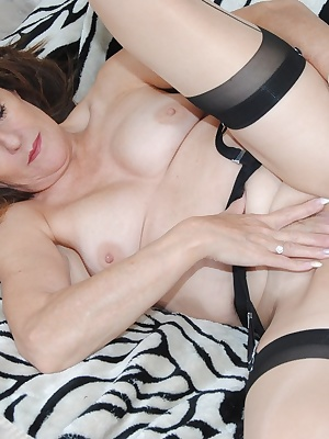 Pictures of Pandora naked on her bed playing and riding her Dildo.