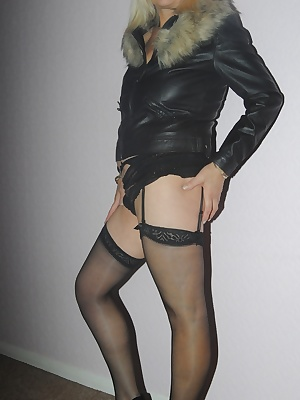 Dressed only in her leather jacket with fur trim panties and stockings Platinum Lady flashes her tits then removes her p