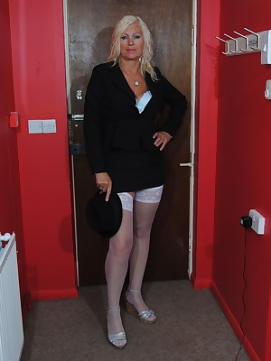 Platinum Lady comes in from her job in city dressed only as she can. Her skirt is so short it only comes down to the top