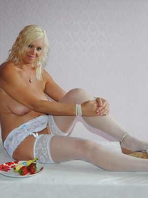Pictures of platinum Blond eating a banana dipped in cream wearing just a white suspender belt and stockings NO panties