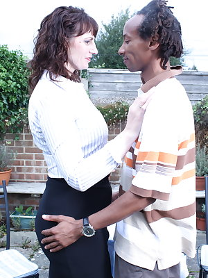British mom fooling around with a black guy in her garden