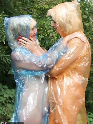 Pictures of Dimonty and Molly in their clear plastic rain coats and naked underneath