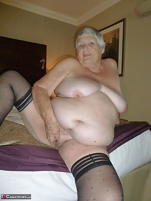 Grandma enjoying herself in a hotel again  By request I wore my sexy pink satin slip with black stockings but as usual I