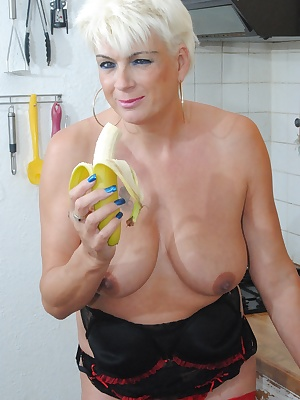 Pictures of Dimonty in her maids out fit fucking with a banana, a cucumber and a carrot.