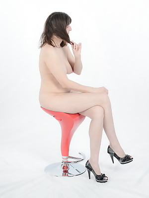 Seats on a stool.Only my heels, I'm still.Posing with a difference.