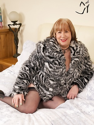 Time to play and im wearing my new animal print fur coat with my Black Basque, stockings and heels but I soon strip off