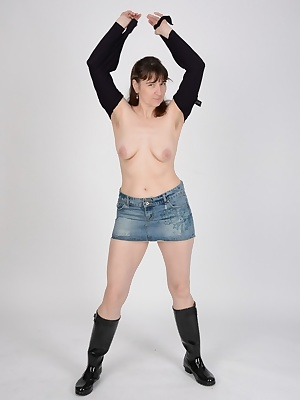 The good Hunter Rubber Boots and to a combination of jeans mini skirt and blouse.Looks a bit like a Maid of the Alm.