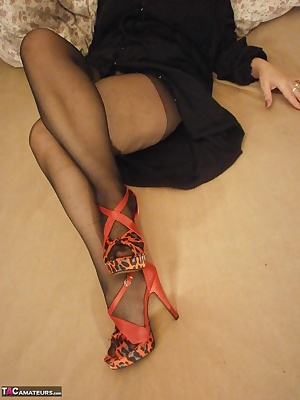High heels and legs covered in pantyhose.