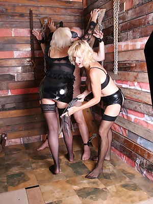 Dimonty and Molly Maracas are dressed in there PVC bondage gear and strap there victim to whip and abuse him