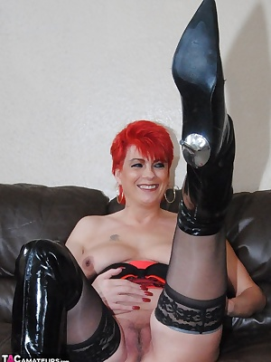 Pictures in my thigh lenghth PVC boot and black and red lingerie.