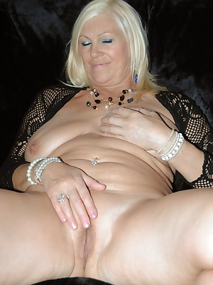 English Lady fingers her wet pussy.