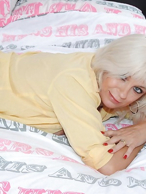 Pictures of the very sexy GILF Dimonty in my yellow shirt, stockings with no bra or panties.Finally she ends up naked on