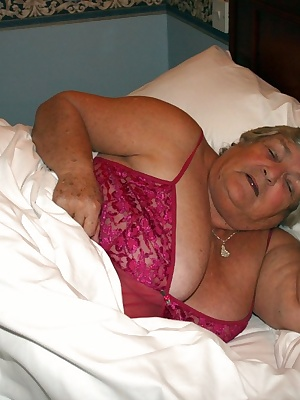 Grandma  in bed and feeling horny.  Wanting a nice man with a big cock to come and play.  Oh well, I have to play with m