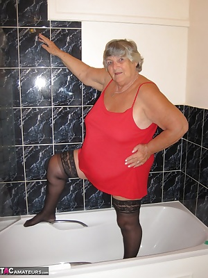 Black stockings and a red babydoll in the shower  See how the water makes the red shift cling to grannys BBW body.. show