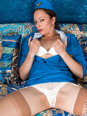 A flight attendant uniform highlights all of the hot curves that all natural mom Claire Adams brings to the table. This cock craving milf takes her time peeling off her clothes so that she can enjoy every touch to her sensitive tits, diamond hard nipples,