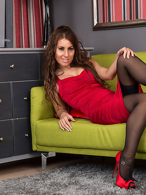 All natural milf Jess West is a British hottie whose tight miniskirt dress accentuates her lush curves and gives you a peek at her thigh high stockings. Once she starts peeling off her clothes, including her tight thong, you will love gazing upon her cum