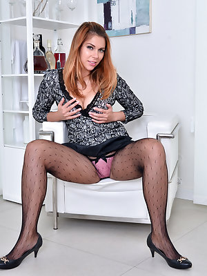 30 year old Ani Blackfoot is feeling the urge to cum, so she is quick to get out of her miniskirt, thong, and sheer pantyhose. This Russian housewife can't stop once she starts stripping, not when her creamy fuck hole is already throbbing with excitement