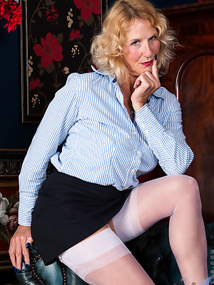 52 year old Molly Maracas is just in from a day of work, and it's time for this grandmother to relax with some self seduction. It's not long before she has started a slow striptease that gradually reveals her huge breasts and rock hard nipples, then allow