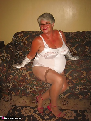 Pretty in my pink lingerie and white body shaper, HOT mama gets you hard...xxx