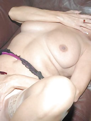 Dimonty strips off her stockings and suspender belt, plays with her pussy with her fingers spreads her legs wide to reve
