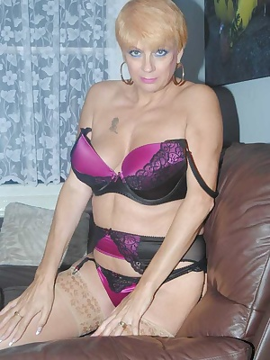 Dimonty strips off her bra and panties down to her stockings and suspender belt, plays with her pussy with her fingers.