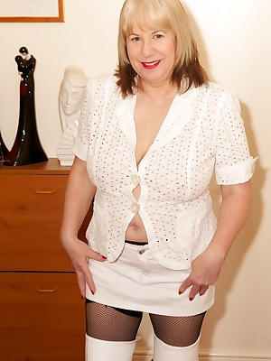 All in white for this shoot apart from my Black fishnet stockings which contrast well with my white Boots, after strippi
