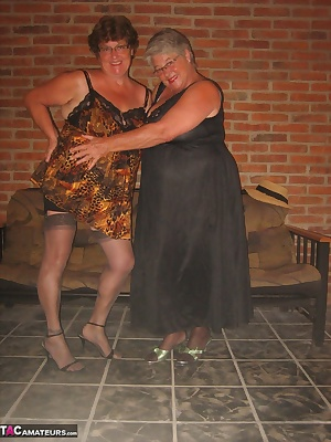 Girdlegoddess and Mistress Sue, hot and sexy together in our girdles and stockings. Cum on baby, be the meat in our sand