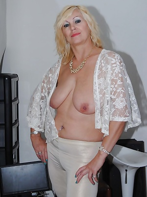 Wearing white trousers and a see thru white top start my flashing while wearing a bra then remove it to flash her great