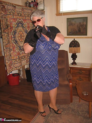 Girdlegoddess in her sunglasses, gloves and smoking, dressed as a typical mature MILF. Who would think that under that d