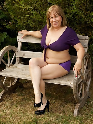 Hi Guys, in the Garden again in my Purple Hotpants and short tie top but it was such a lovely day I just had to strip of