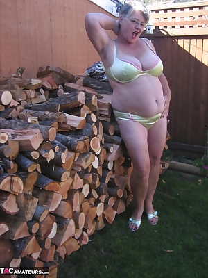 Hot Mama out at the woodpile. I'm waiting for you naughty boy,You might need a spanking