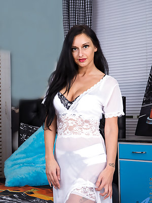 All natural mom Cassie Clarke gets ready for bed, peeling off her sheer gown and bra and panties until she's wearing nothing but a garter belt to hold up her stockings and a come hither smile. This mature delight will leave you breathless as she shows off